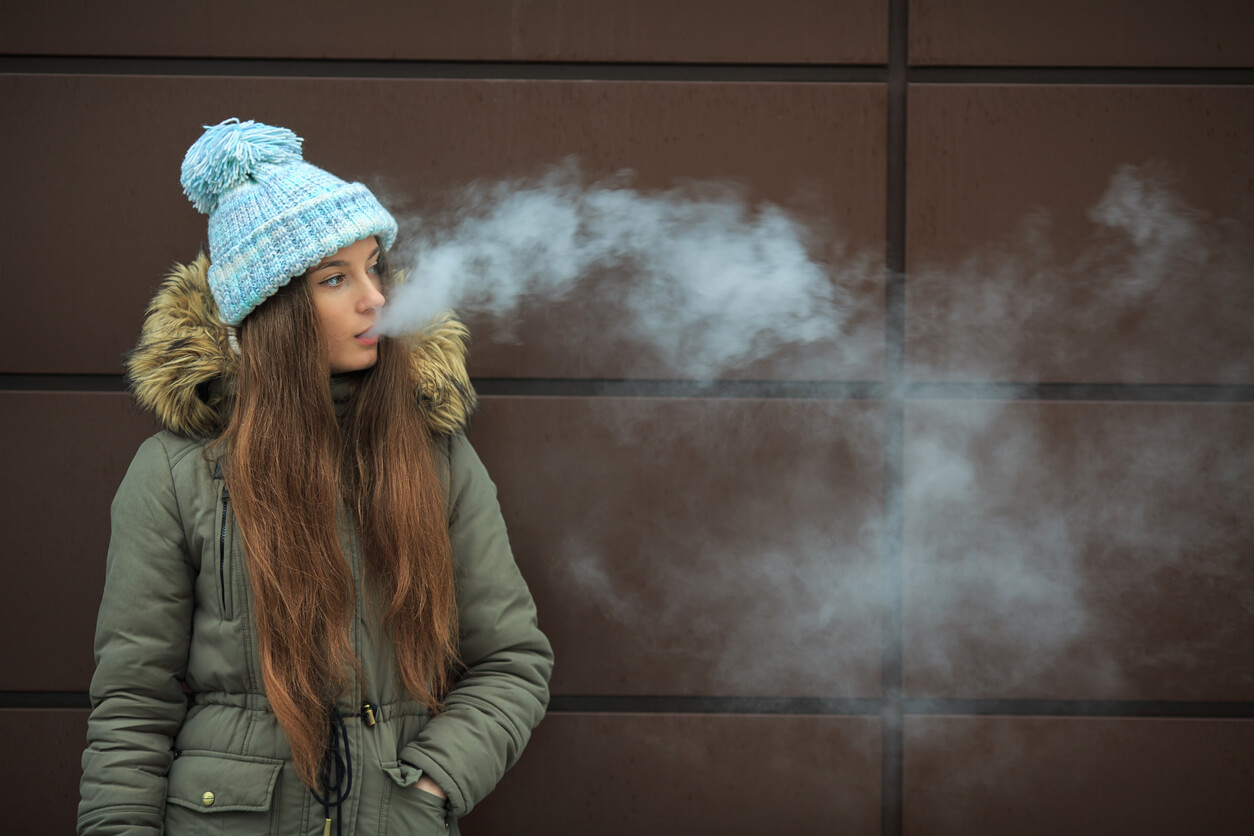 Stock image showing a girl vaping